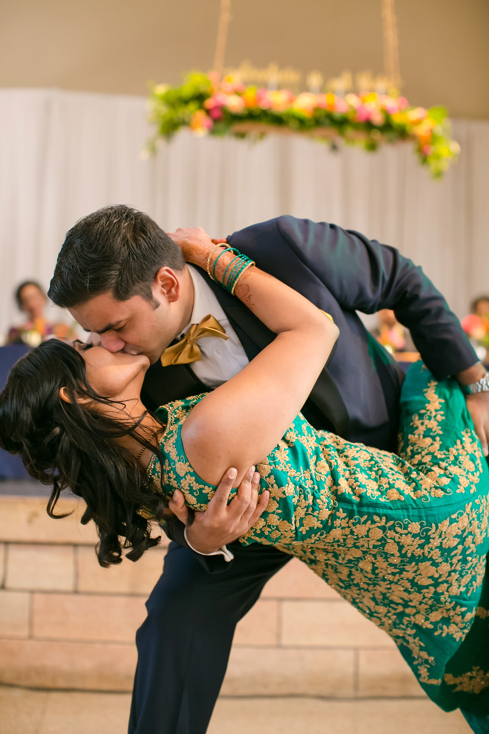 Vendors: Photographer:  Jeannine Marie Photography  | Planner:  Kerry , The Simply Elegant Group | Ceremony:  Hindu Temple in Maple Grove  | Next Day Reception:  Harriet Island Pavilion in St. Paul  | Caterer:  India Palace  | Serving Staff:  Big 10 Catering  | Bartenders:  With a Twist  | Cake:  Miss Sara's Cakery  | Hair/Makeup:   Mani Mela  | DJ : Sharabi | Florist : Whimsy  | Cafe Lighting:  Festivities  | Photobooth:  VIP Photo Booth