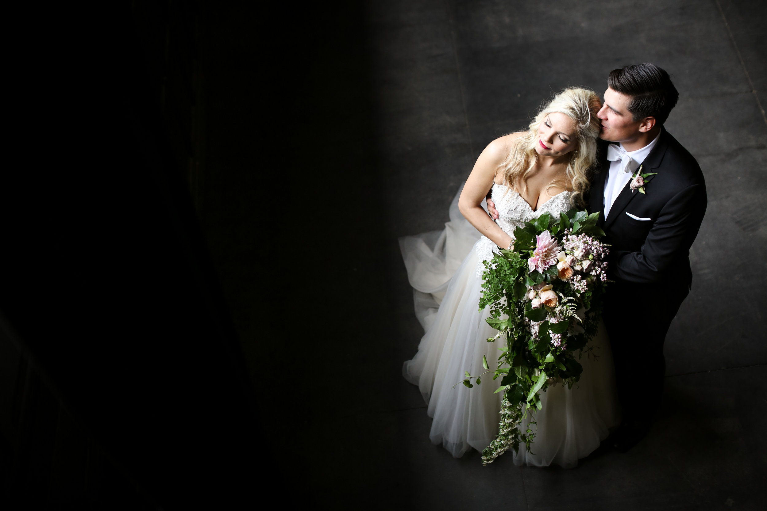 Photographer: Vick Photography ( here is their blog post)  Makeup: Makeup by Mindie   Hair: Hair by Theresa    Dress: The Wedding Shoppe   Venue: Aria    Planning: Elisa ,Simply Elegant   Cinema: Better Together    Florist: Whimsy Designs    Dessert: Cafe Donuts    DJ: Instant Request