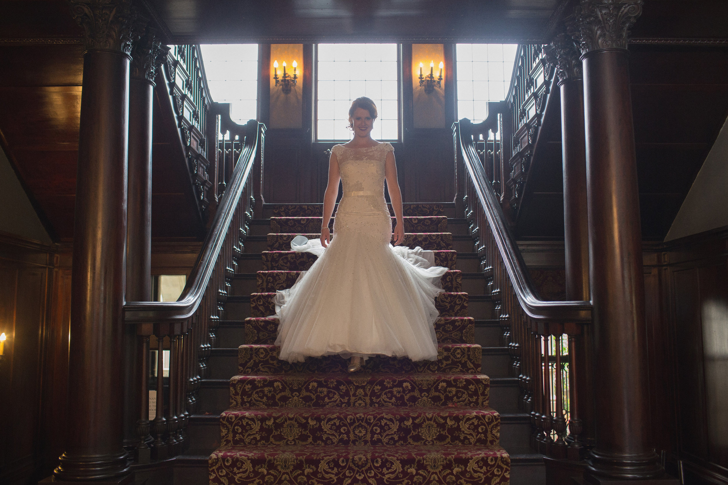 Bride walking down the steps of Semple Mansion