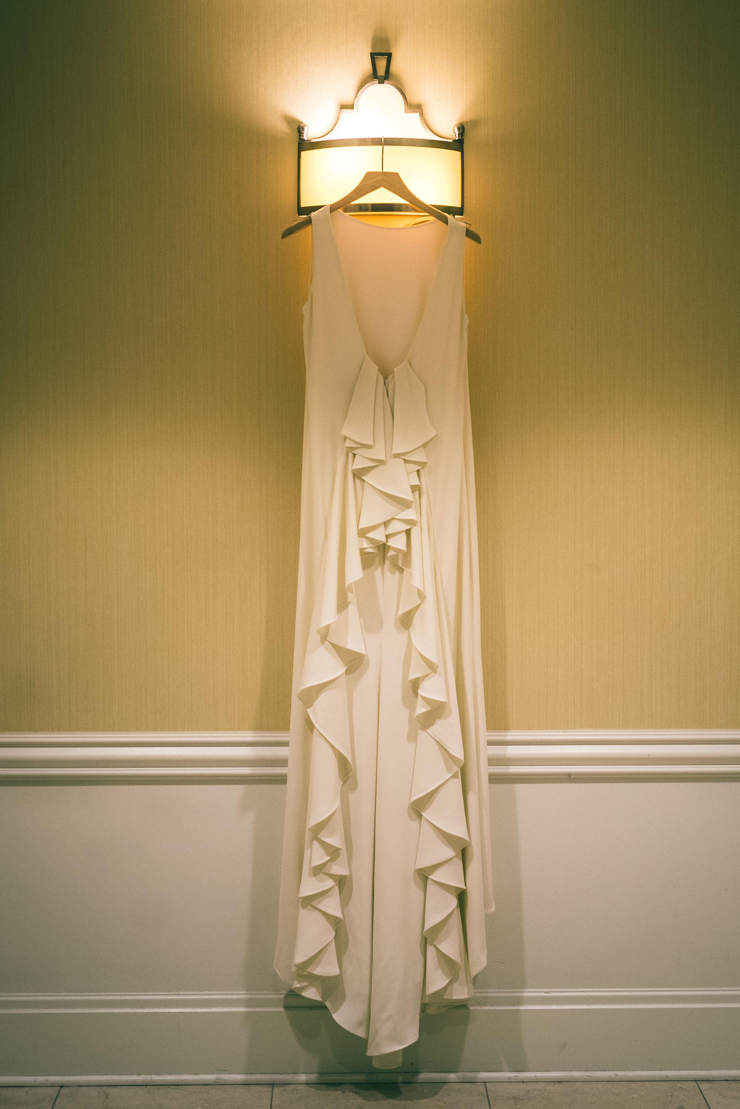 Shift wedding dress with ruffled back