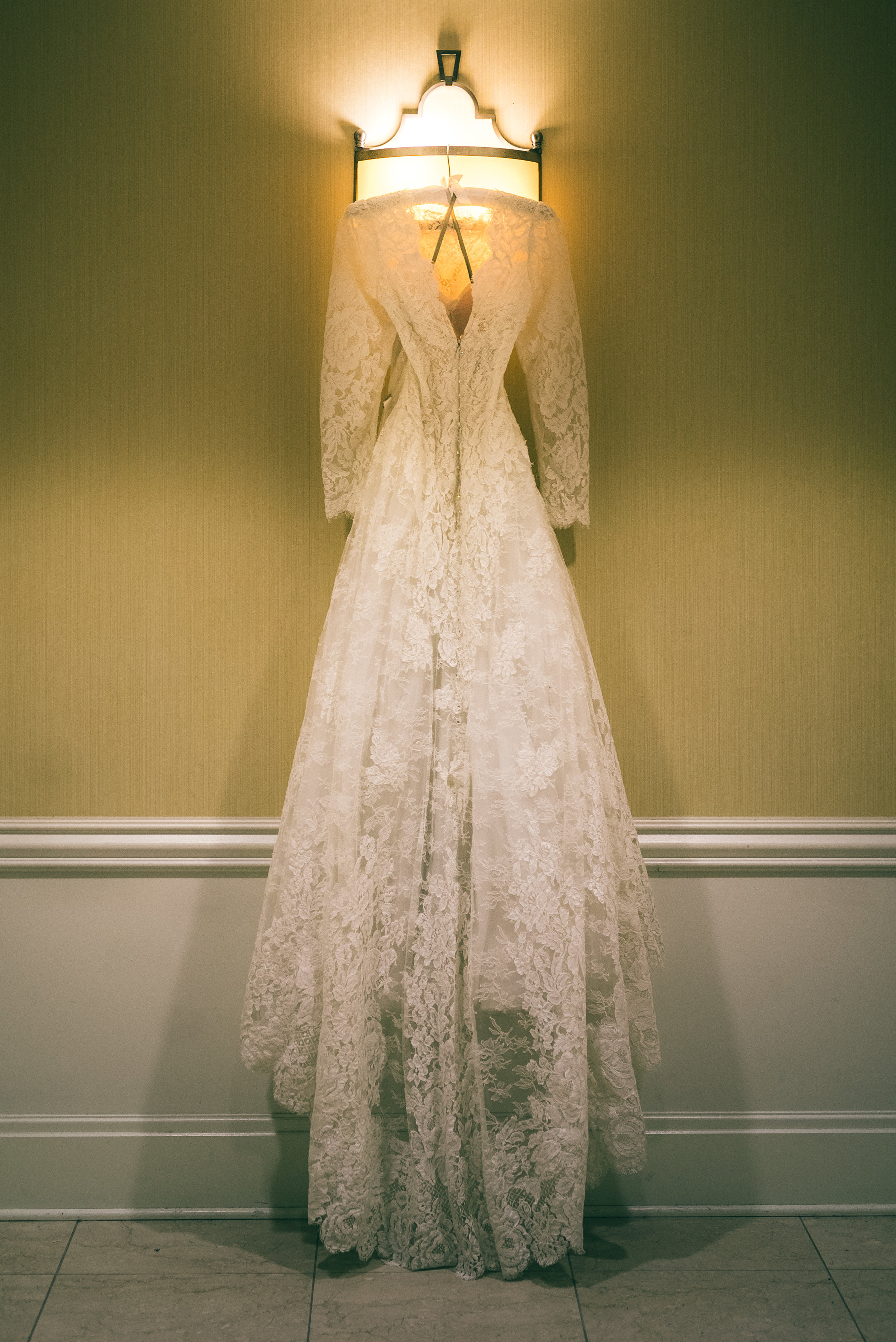 Lace, A-line wedding dress with sleeves.