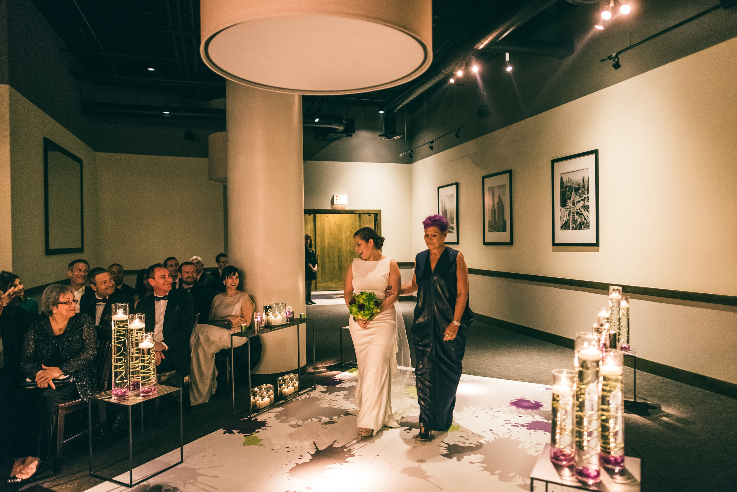 Bride walking down the aisle with her mother for Jewish ceremony at River Roast Social House in Chicago