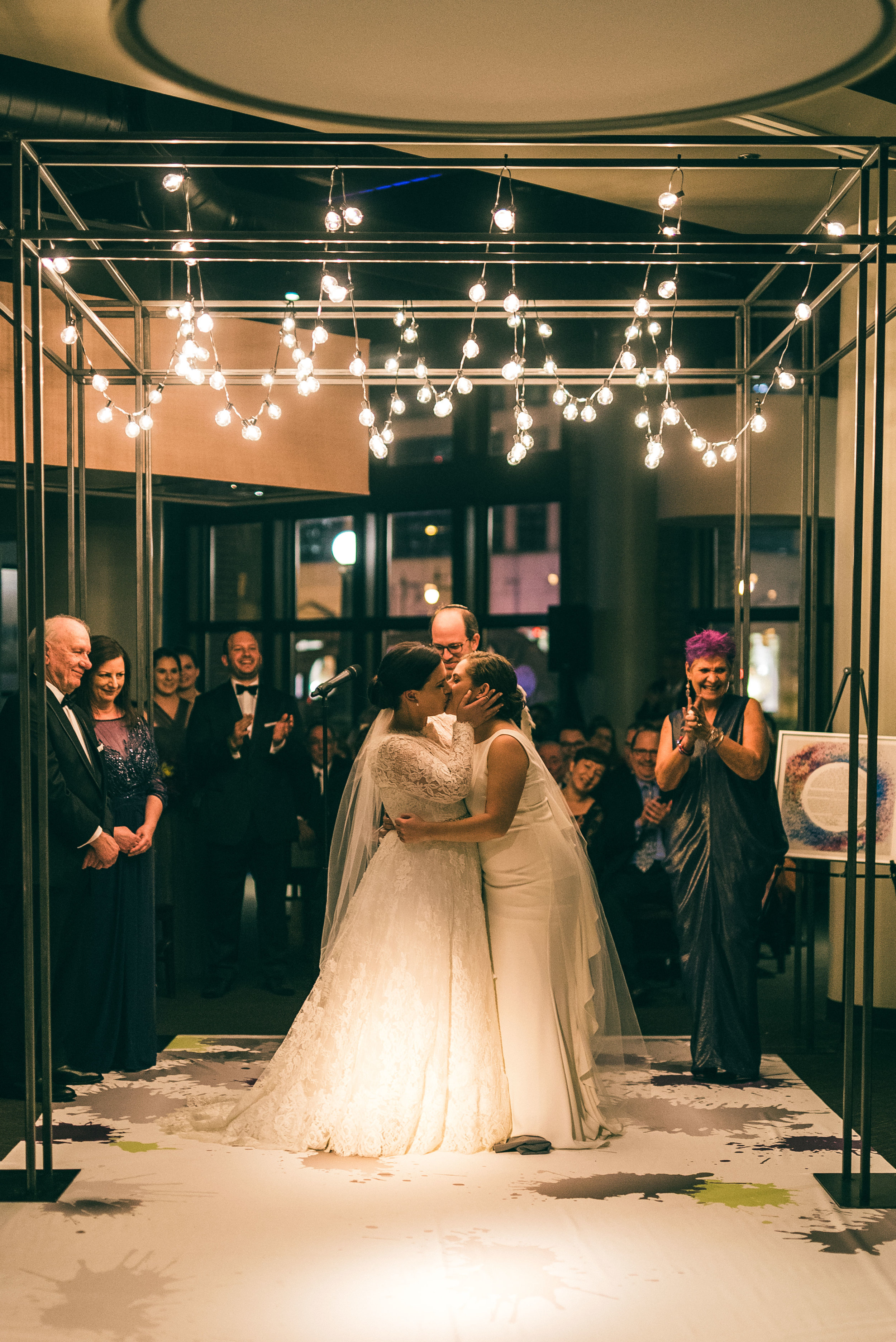 Nighttime Jewish same sex wedding ceremony at River Roast Social House in Chiago