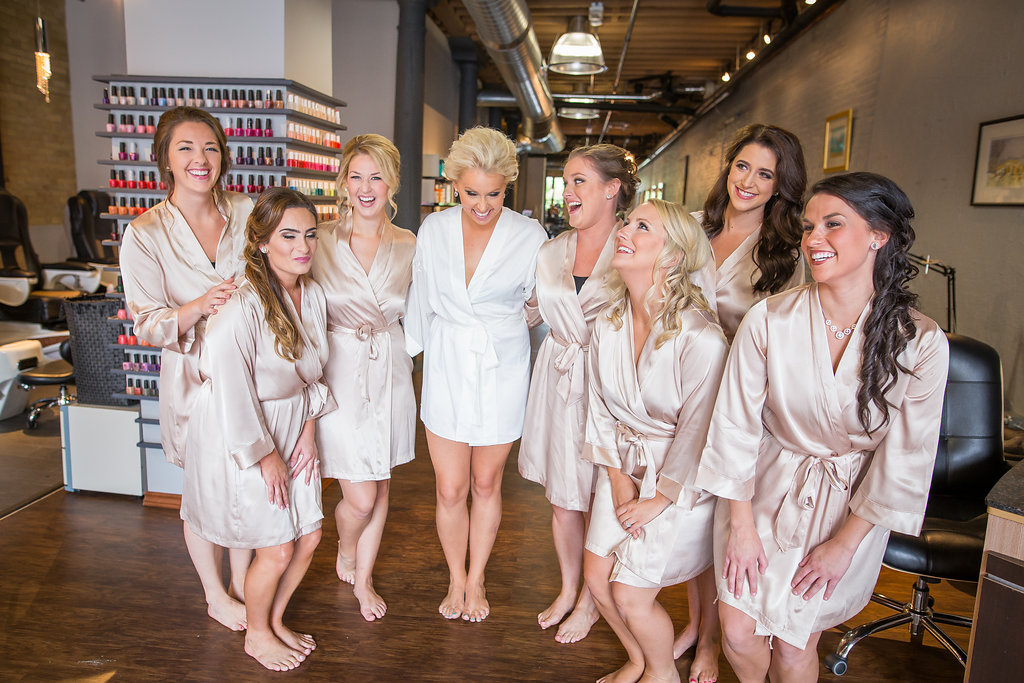 bride with bridesmaids in pink satin robes