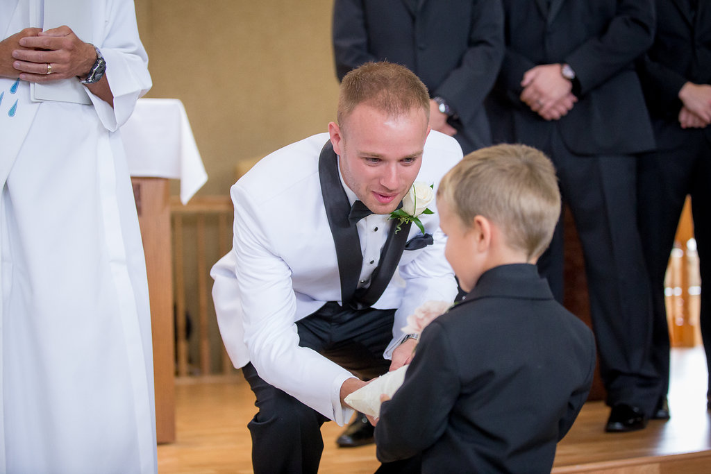 Groom and ring bearer during church ceremony