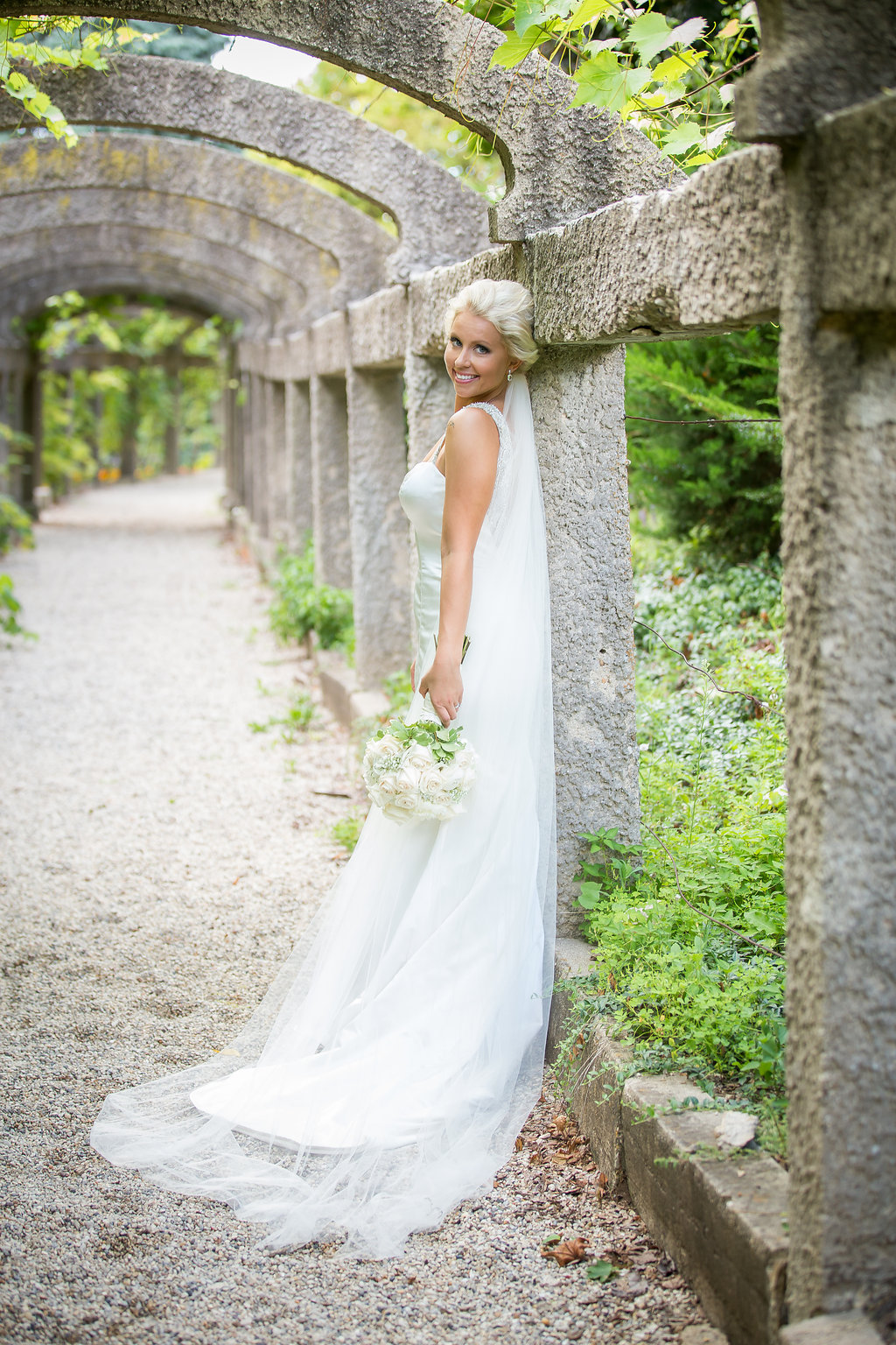 Beautiful bride outside of The War Memorial Center in Milwaukee