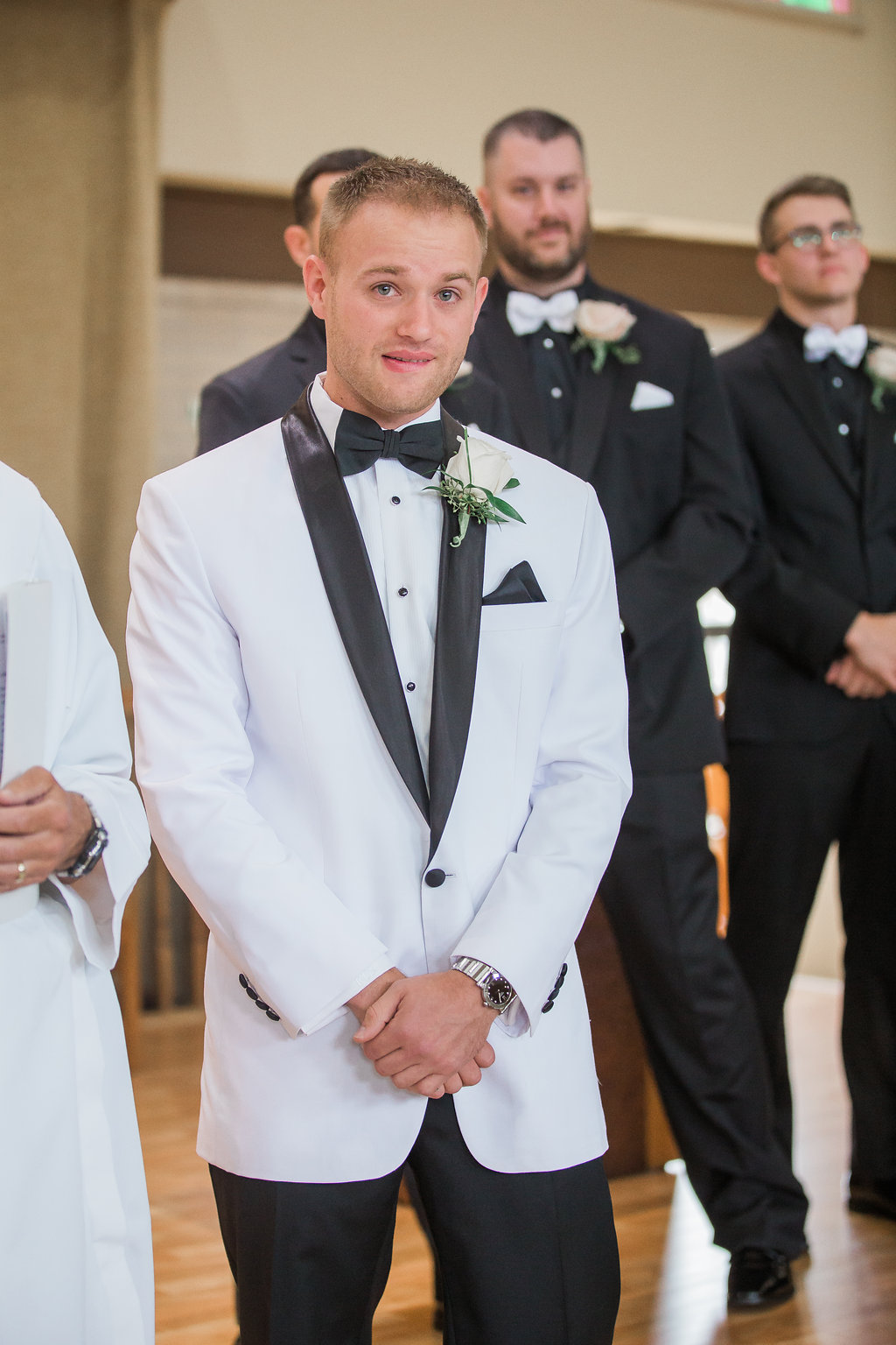 Groom seeing bride for first time during wedding ceremony