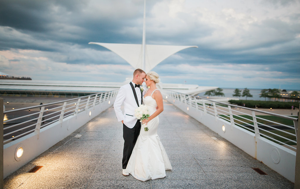 Milwaukee, Wisconsin wedding at the War Memorial Center, bride and groom pose for photo