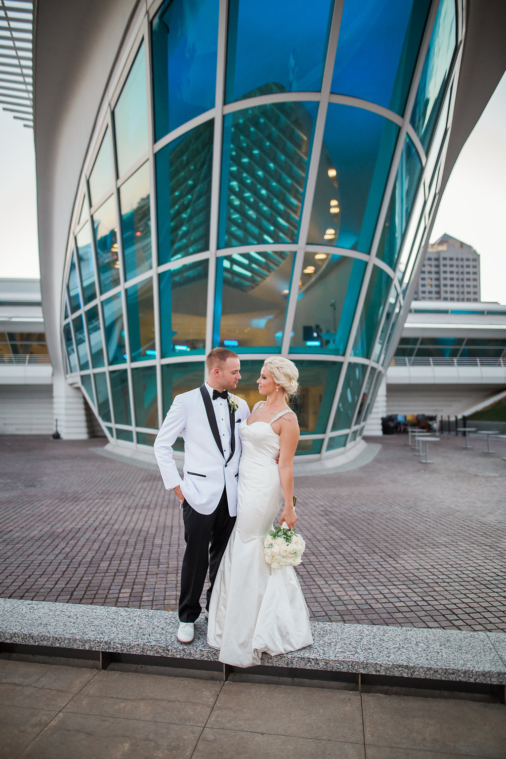 Bride and groom in from of The War Memorial Center Milwaukee, Wisconsin,