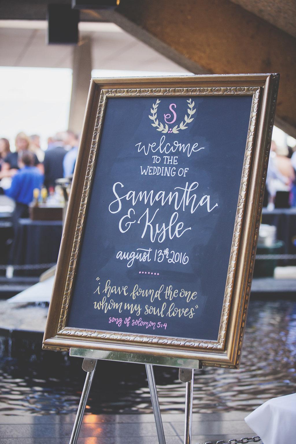 Custom chalkboard sign outside of The War Memorial Center, Milwaukee, Wisconsin summer wedding