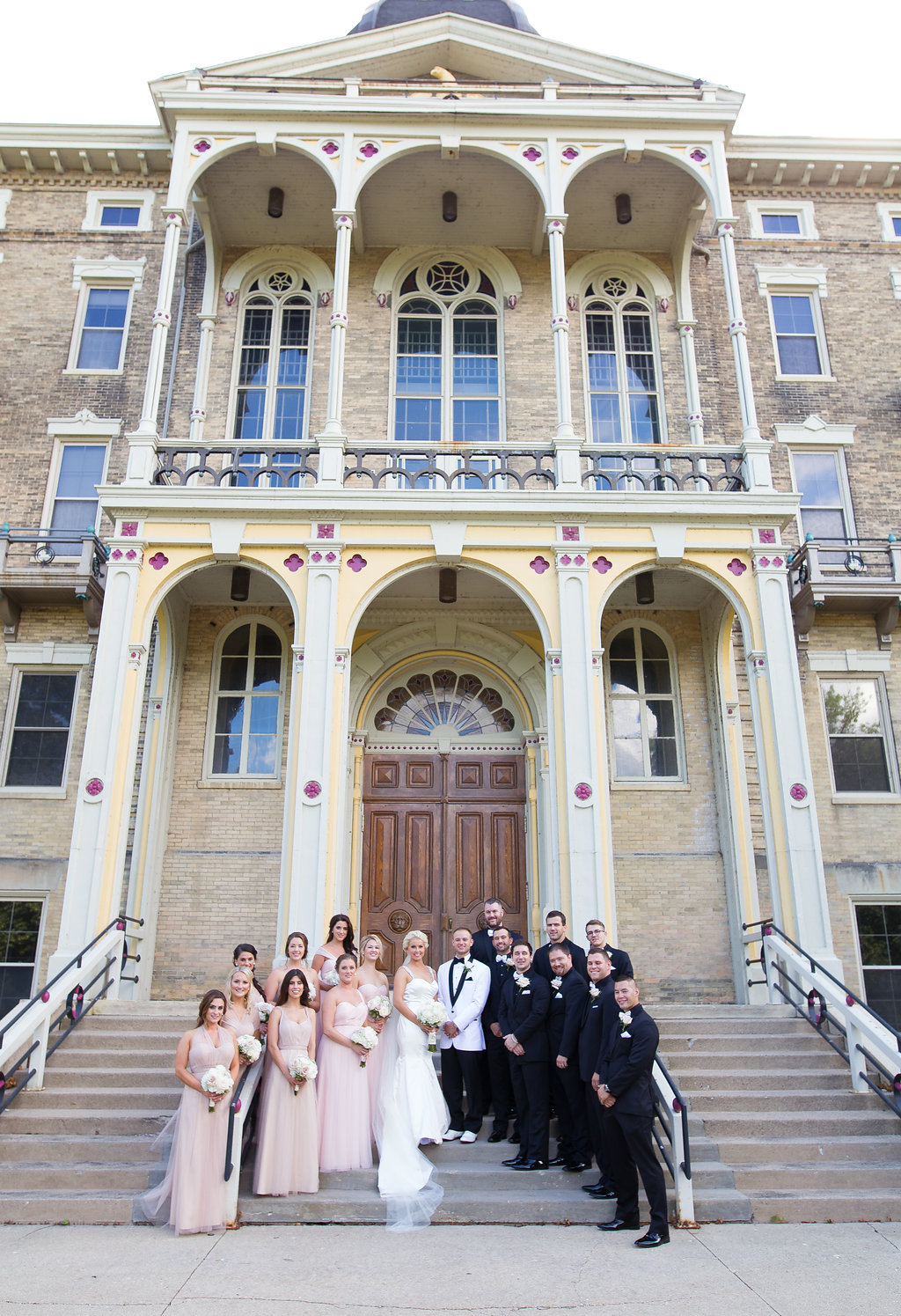 Bride and Groom with bridal party outside of church in Milwaukee, Wisconsin
