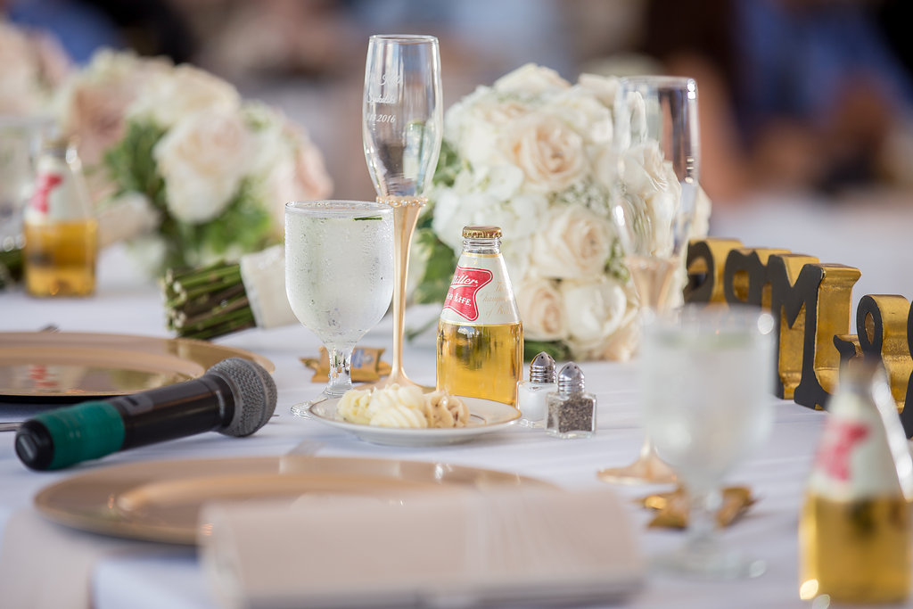 Miller High-Life favors. Blush and gold wedding decor, white tented reception at The War Memorial Center, Milwaukee Wisconsin wedding planner