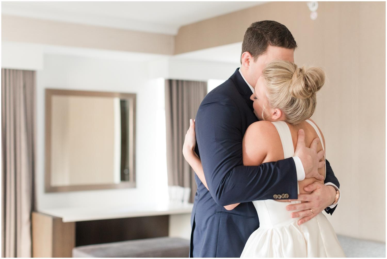 bride and groom hug before their wedding