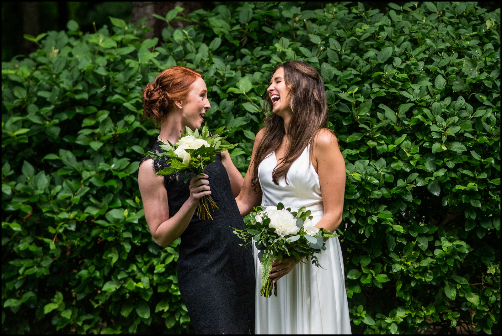 bride and her bridesmaid holding bouquets