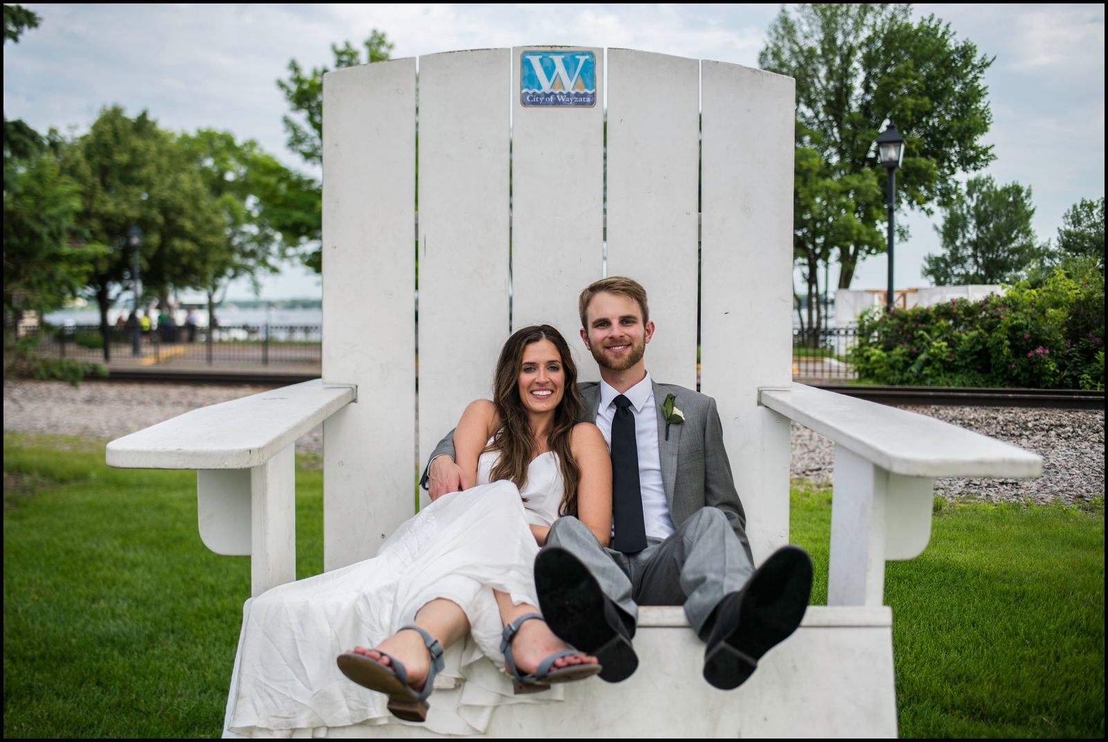 bride and groom sitting on a big chair