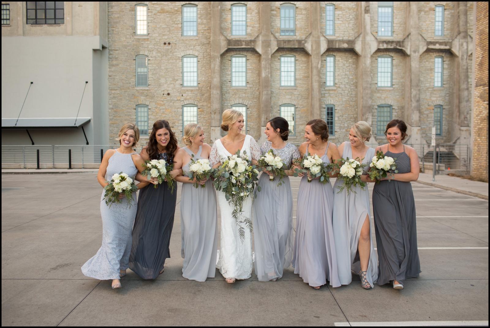 Bridesmaids holding bridal bouquets