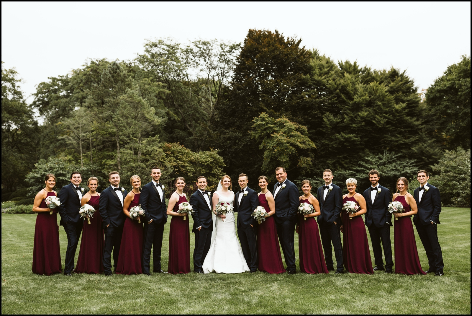 Bridal party with the bride and groom
