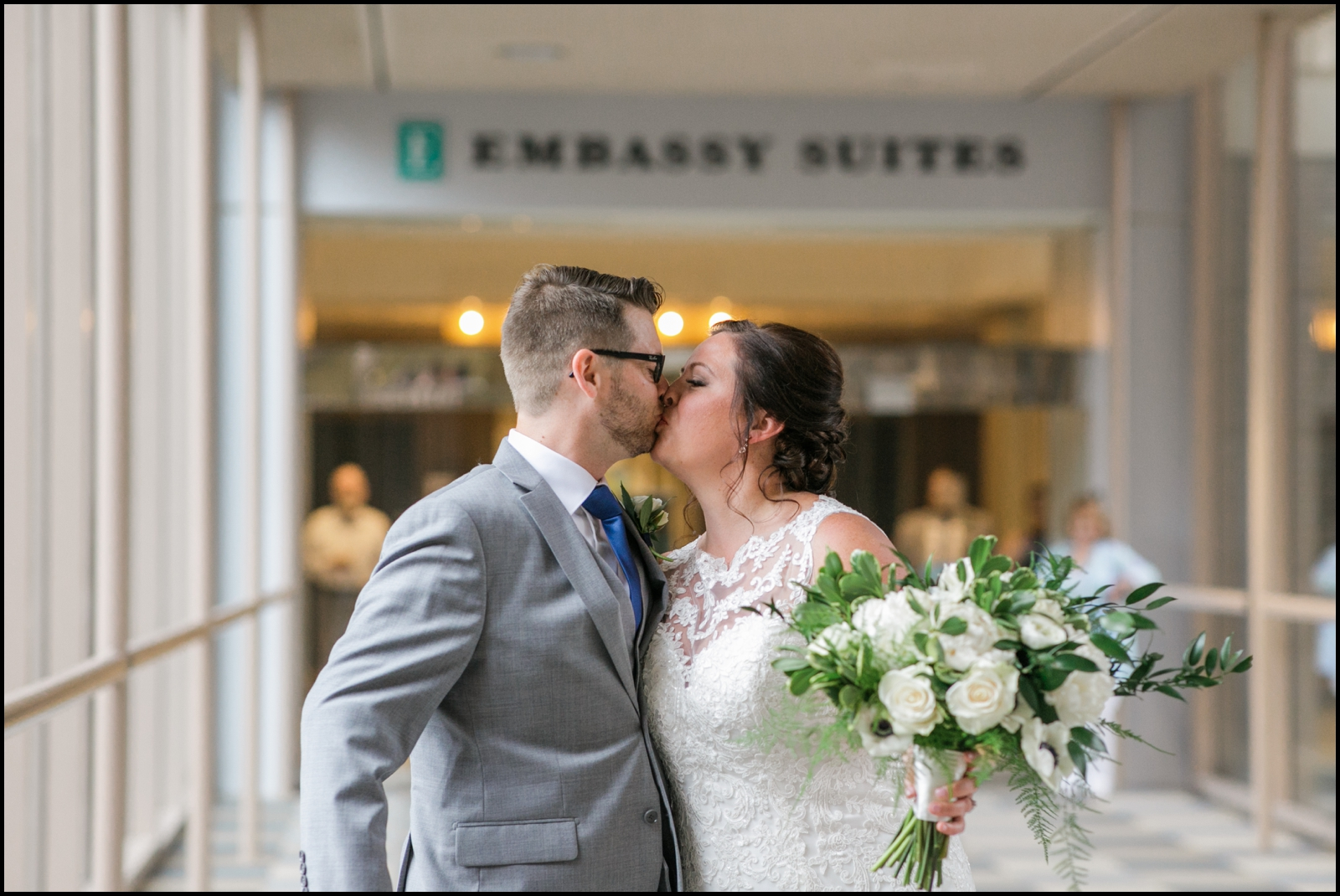 bride and groom's kiss before their wedding in MPLS