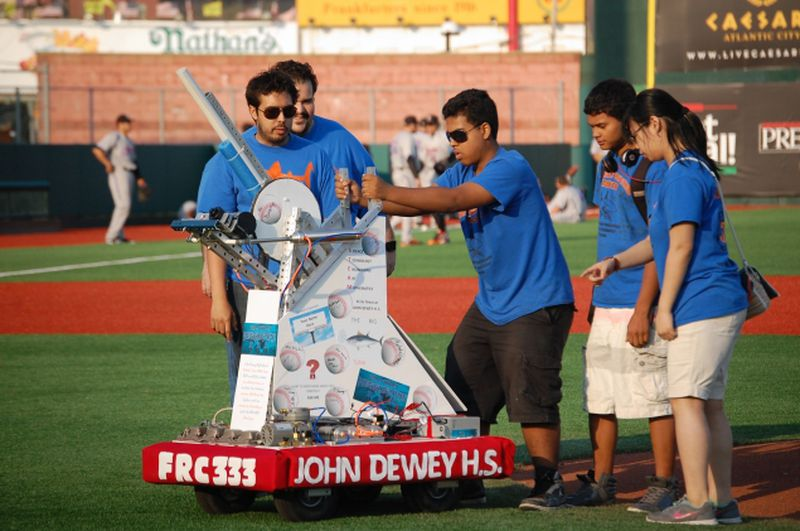 John Dewey High School students unveil mechanical pitcher at MCU Park in Coney Island