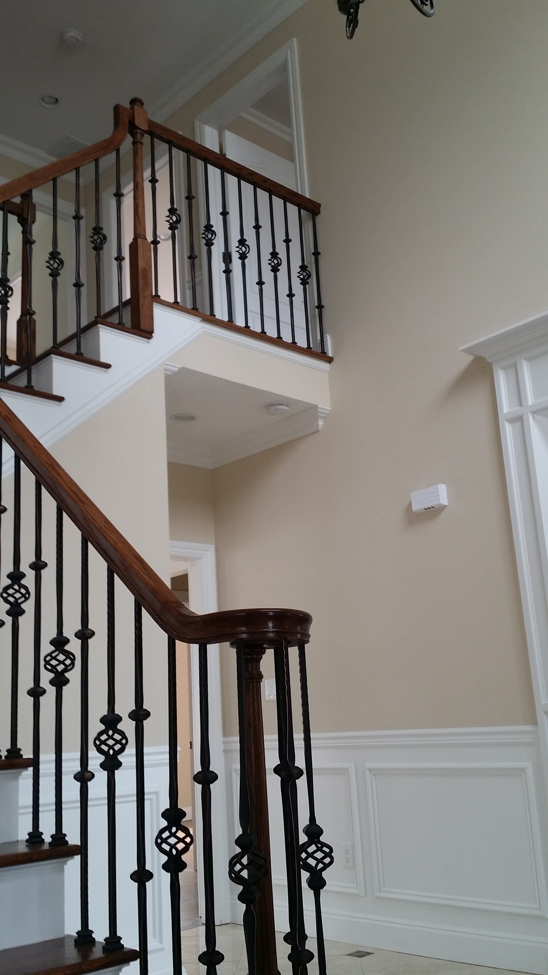 interior foyer painting and railing staining