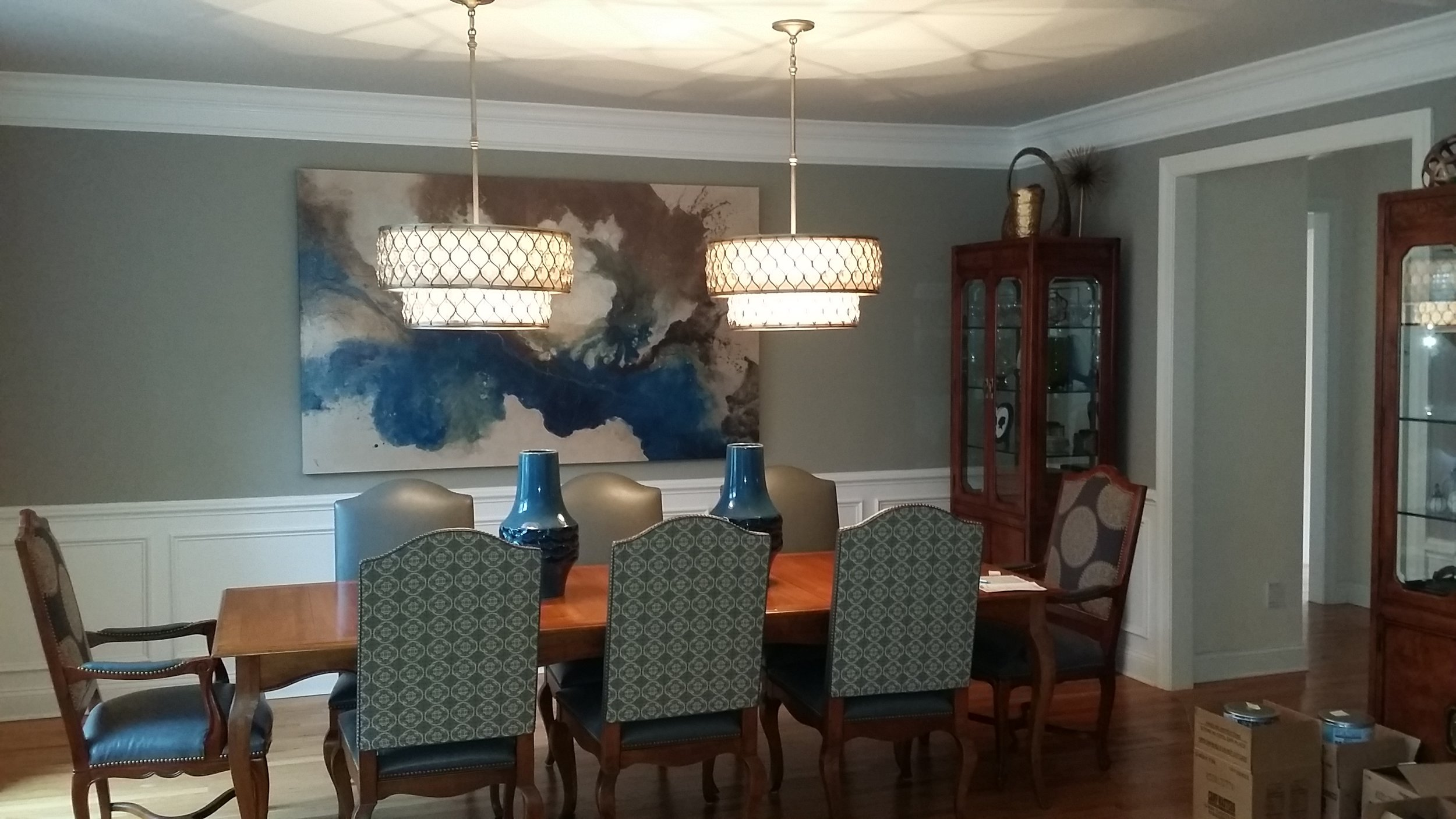 dining room painting of crown molding, wainscotting, and walls