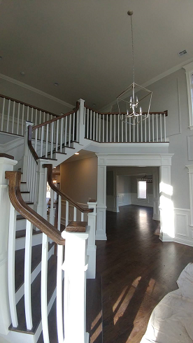 home handrail staining and foyer ceiling and wall painting