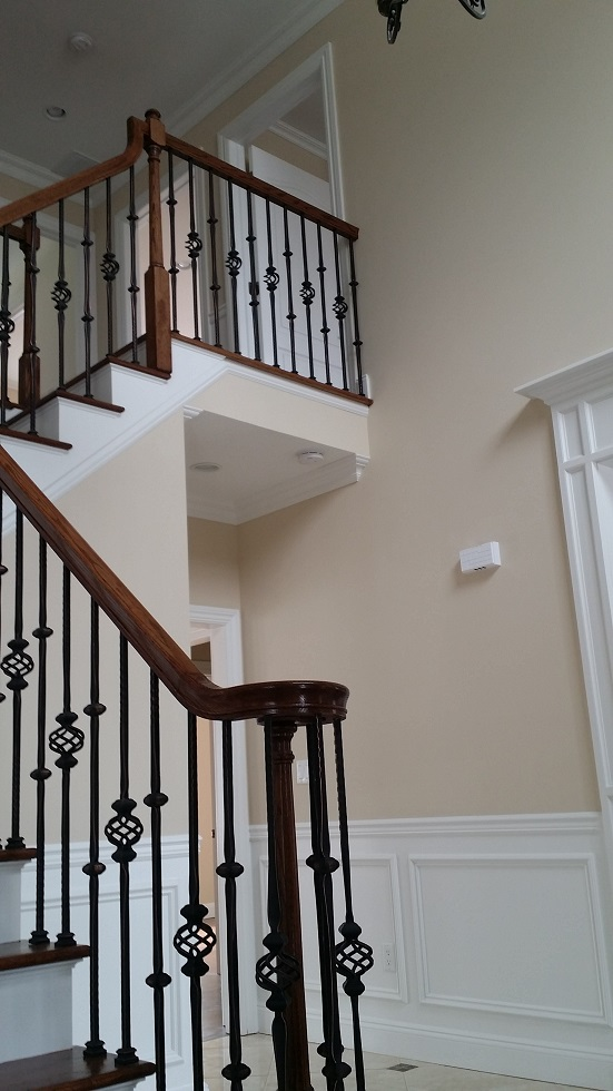 handrail staining and foyer wall painting