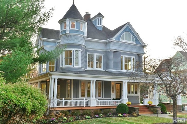 exterior painters paint victorian home with gray and blue wood siding