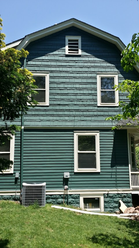 wood house painting by exterior painting company