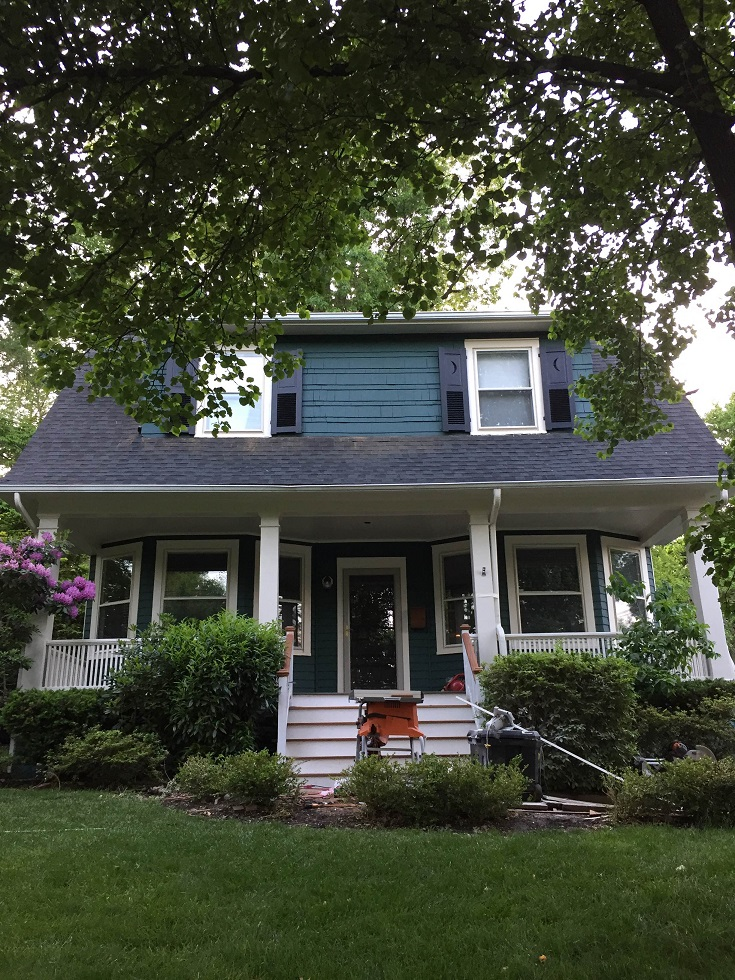 exterior wood siding painted with tarrytown green by professional paining company