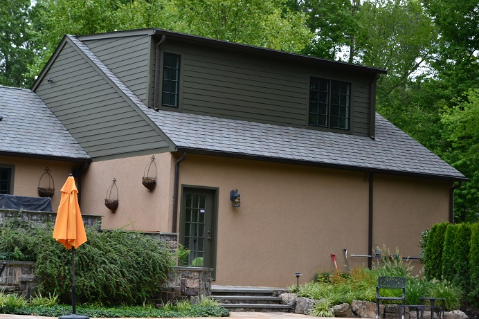 painting company paints home exterior siding