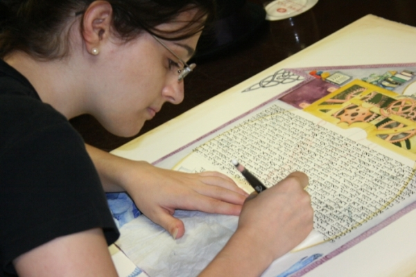 Ariela finishing the last line of the ketubah at my wedding while we were all getting hair and makeup done.