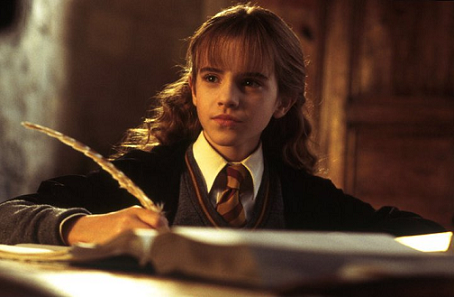 Hermione Granger, portrayed by Emma Watson, using a quill all wrong.