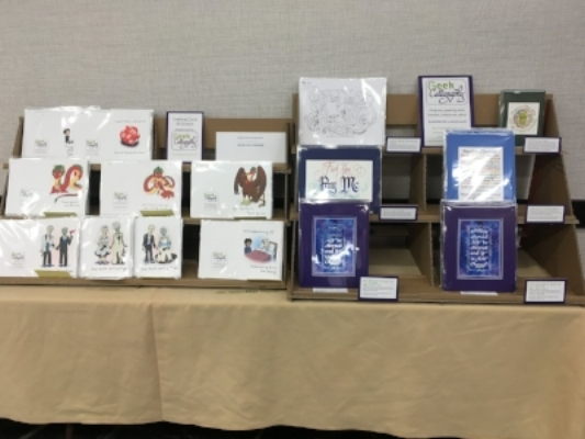 The greeting card and small matted print display.