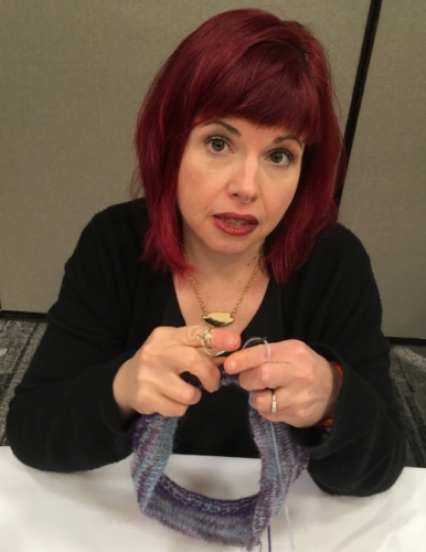 Kelly Sue Deconnick holding the cowl I was working on throughout the weekend.