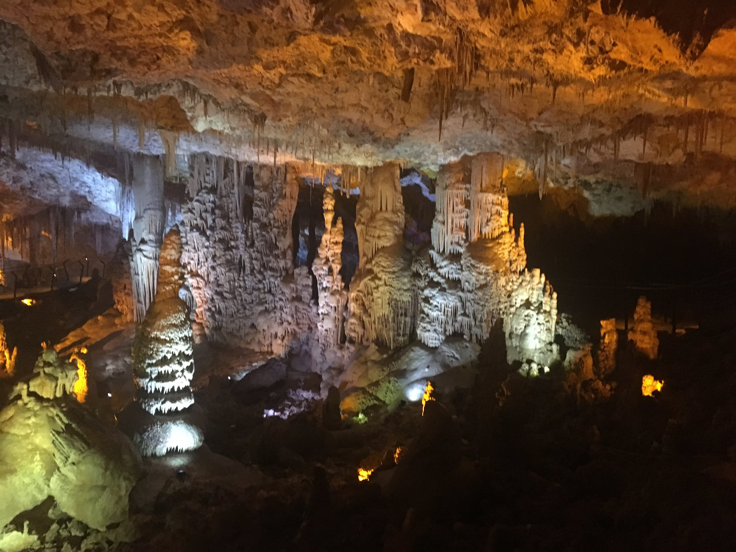 "Wide interior shot of the  stalactite caves  in the Sorek Valley. Visible in the center is the stalagmite feature often referred to as ""the ice cream cone with three scoops."""