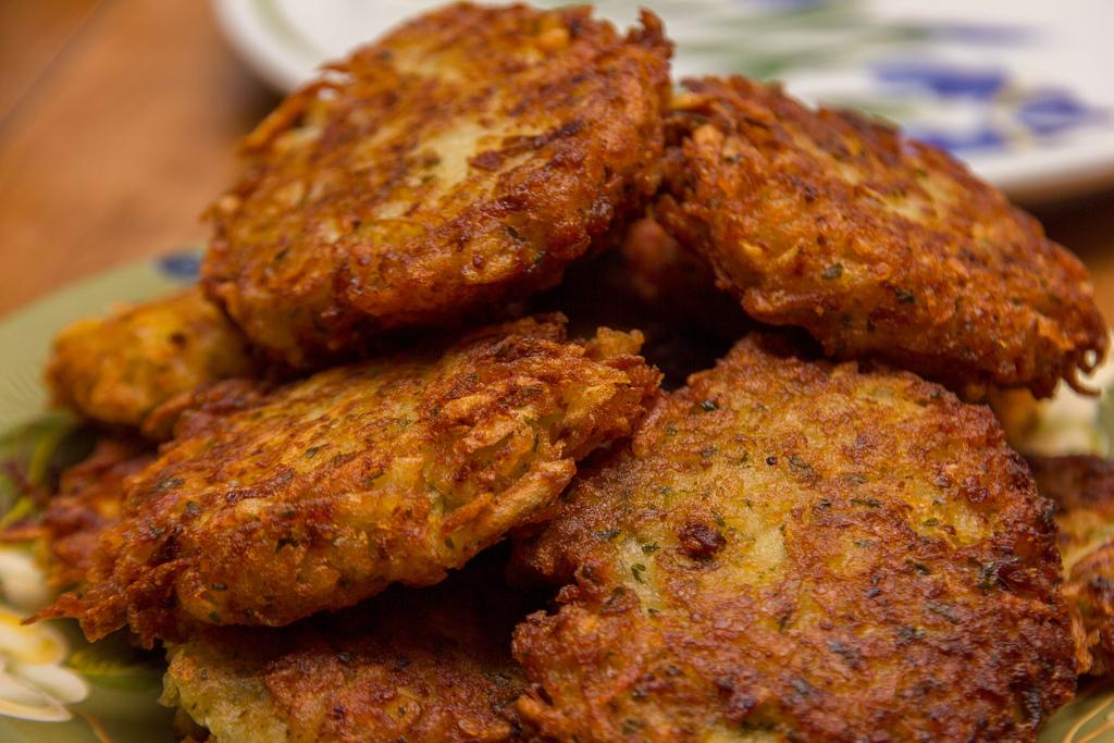Crispy brown potato  latkes  on a plate.