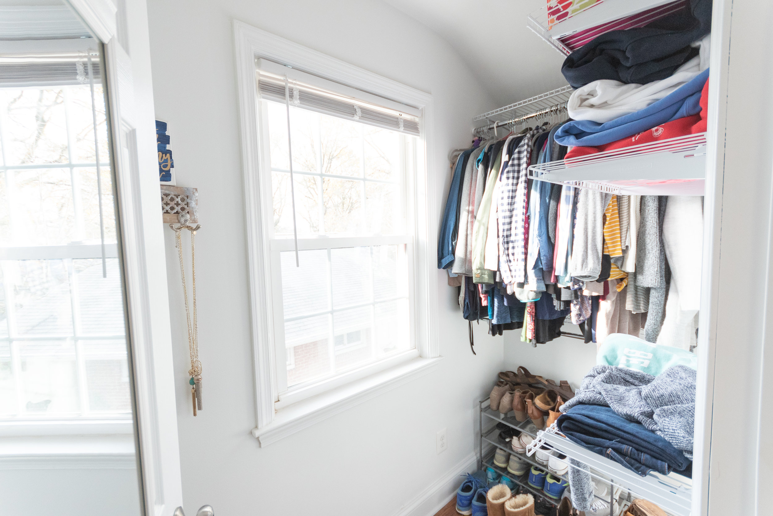 … and my awesome walk in closet that has since been filled completely! So excited to have all my winter and summer clothes up year round instead of having to pack away clothes every season! There is another large closet on the left in our bedroom that Tommy uses.
