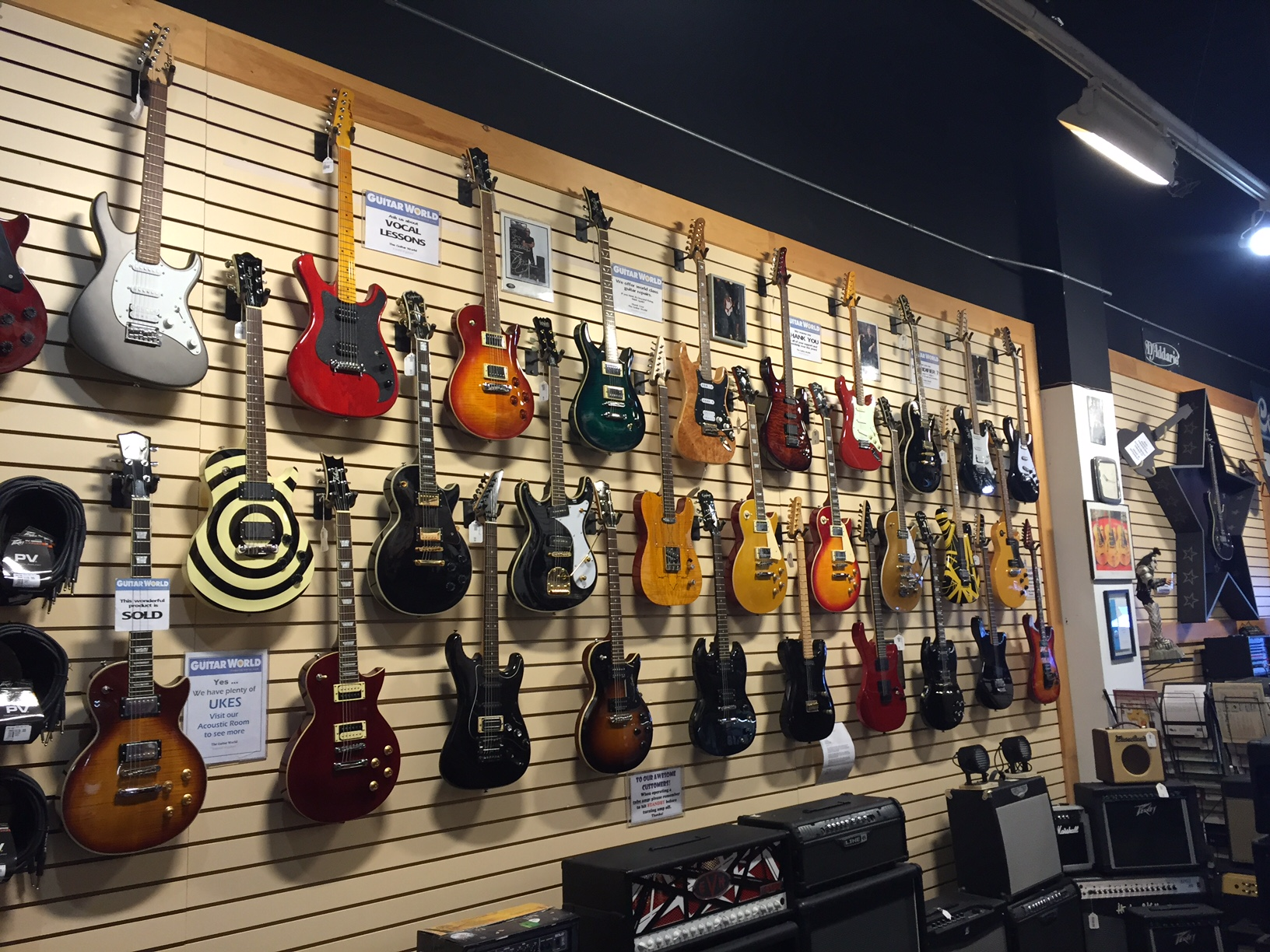 A small example of the large number of guitars in stock