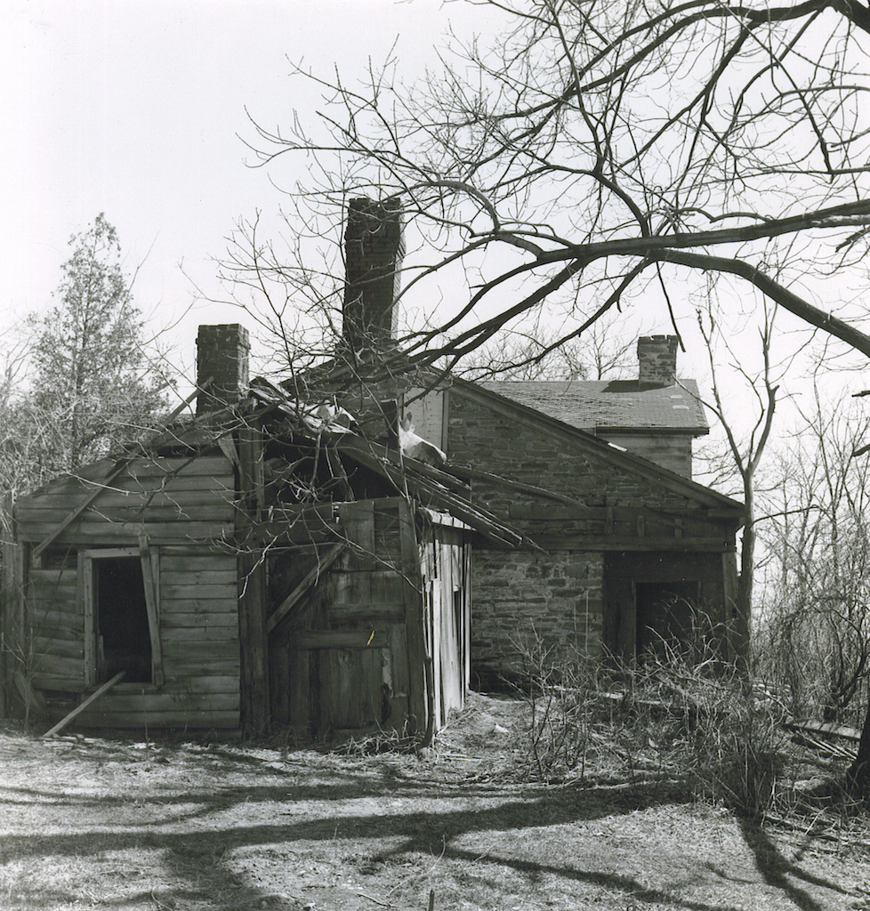 Photo shows the state of disrepair of the structure's adjoining shed prior to the move.
