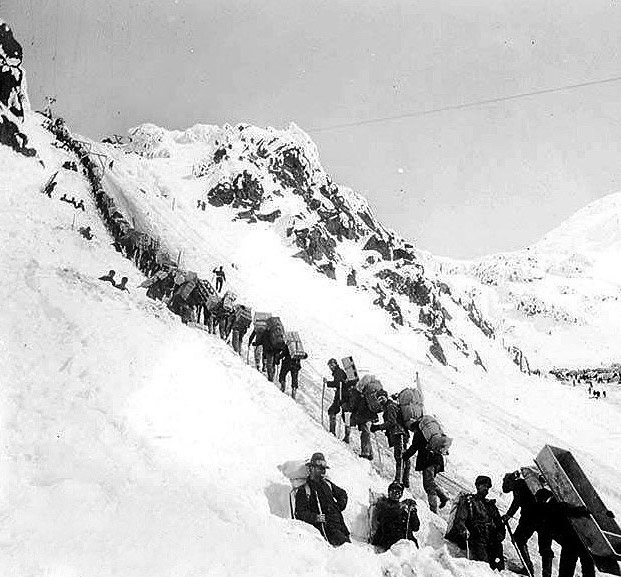 Gold seekers climb the Chilkoot Pass on their way to Dawson City and the goldfields.