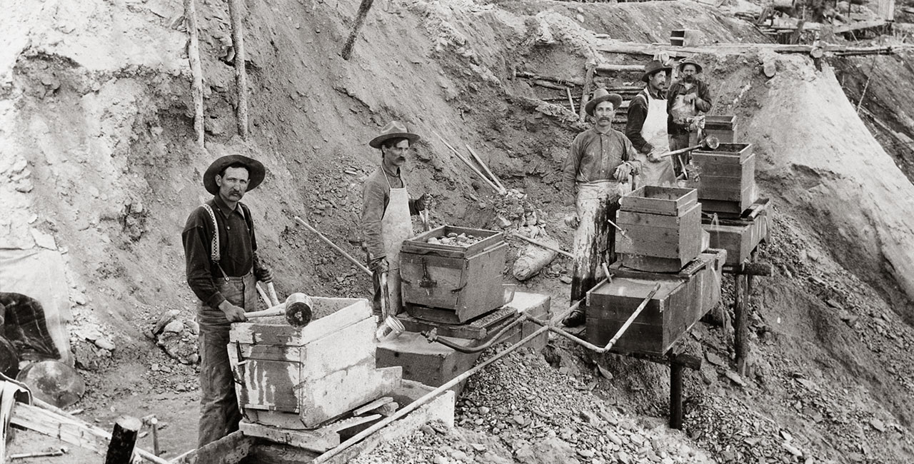 An early typical sluice box mining operation