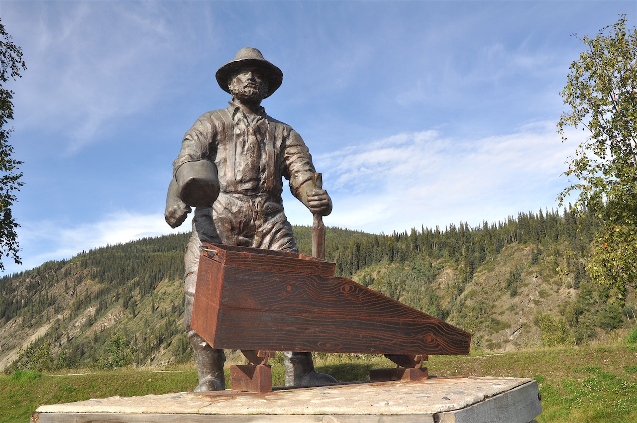 A statue honouring the early miners overlooks Dawson's main street.