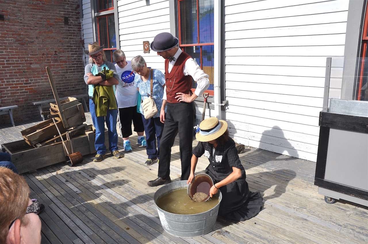 Parks Canada staff demonstrate the art of panning for gold.
