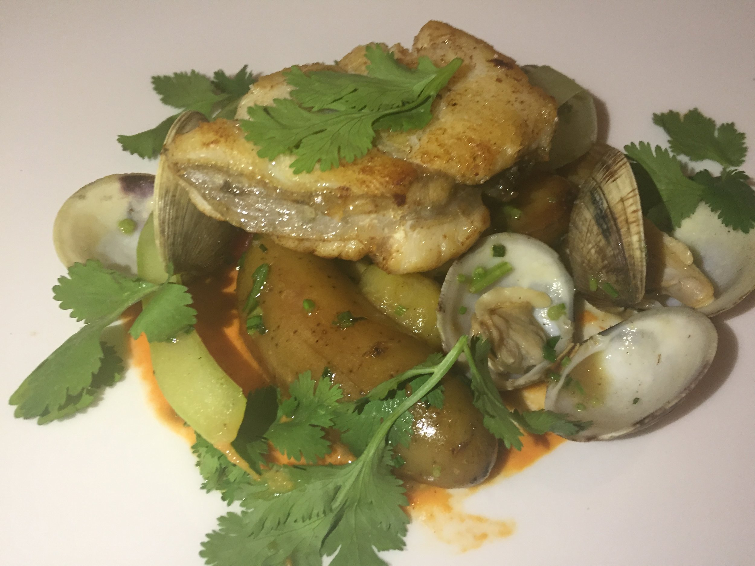 MONKFISH: 'Alentejana' style roasted monkfish, red pepper glazed monkfish, clam in a white wine, tomato and dark chicken stock, and coriander.