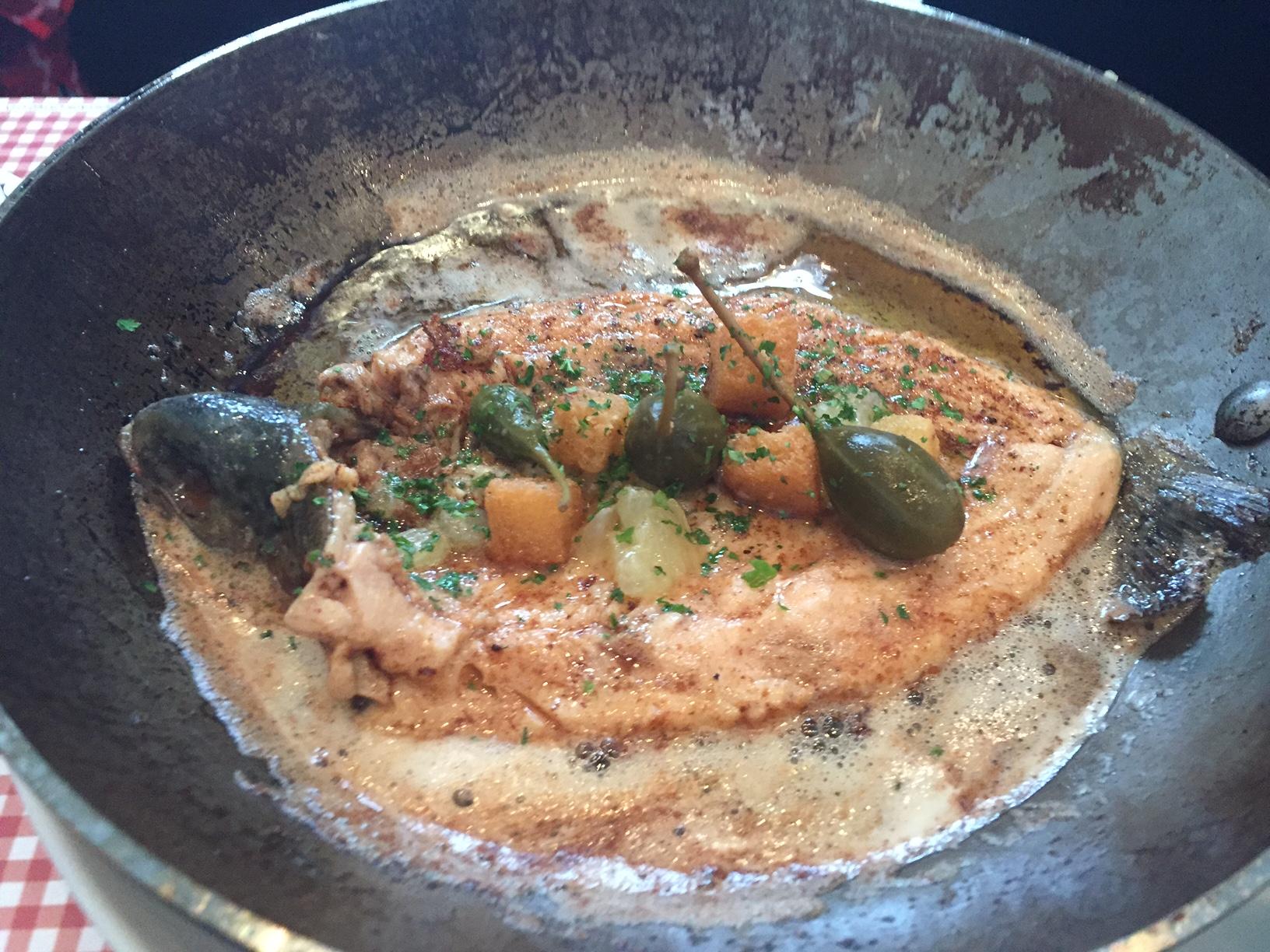 Whole pink trout served À la grenobloise