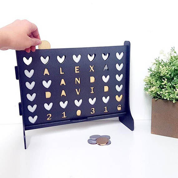 Personalized Fun!Cutts Studio will cut anything, literally, including table top games!Personalized Connect Four, $64.