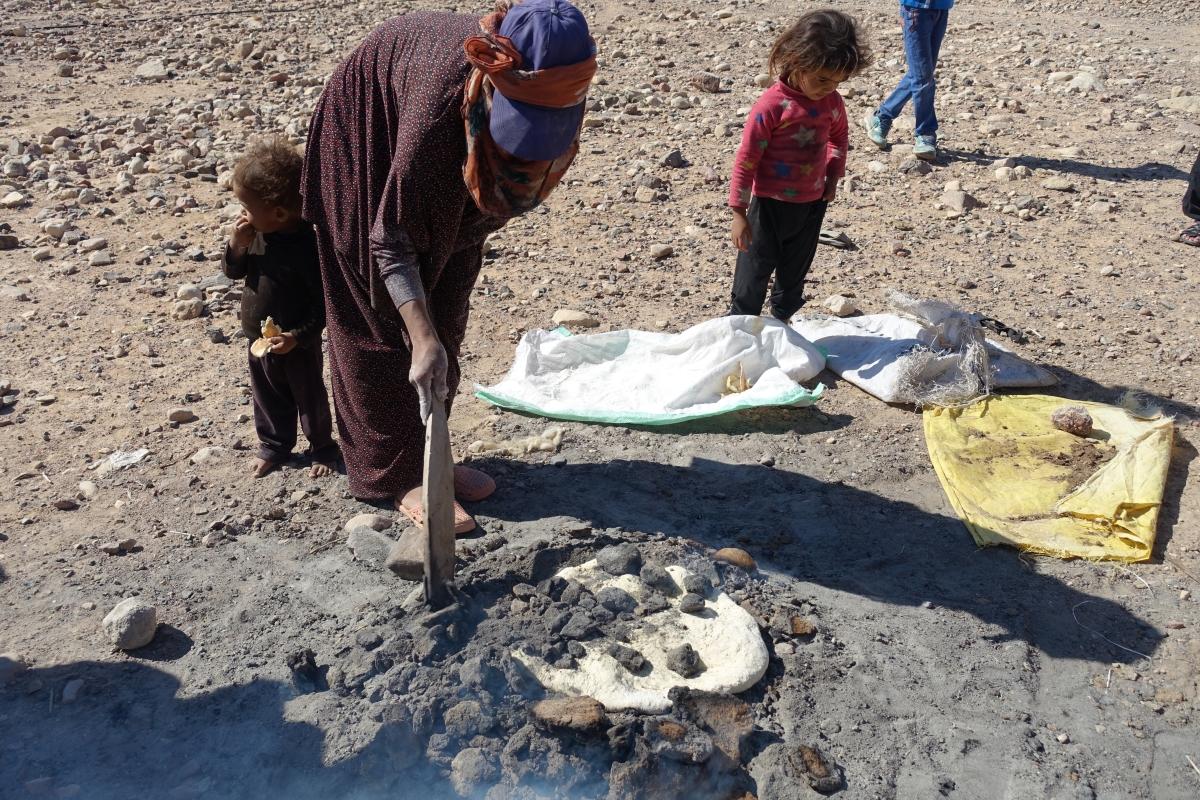 A local Bedouin woman making bread outside her tent @ Brigitte Hasbron