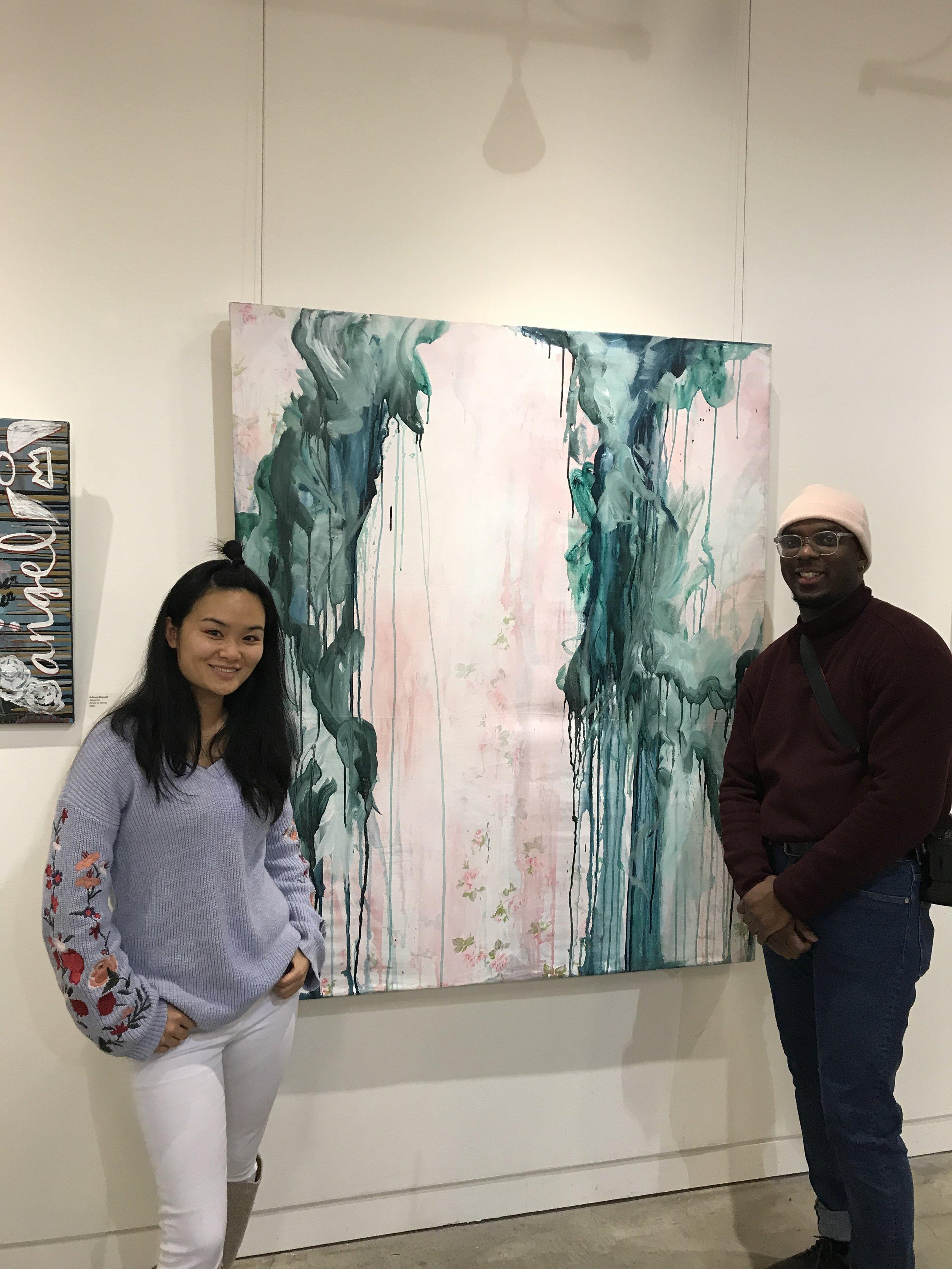 Jacqueline Mak and Johneil Harris in front of La Machine de Reve. No 1 by artist Bella Vita.
