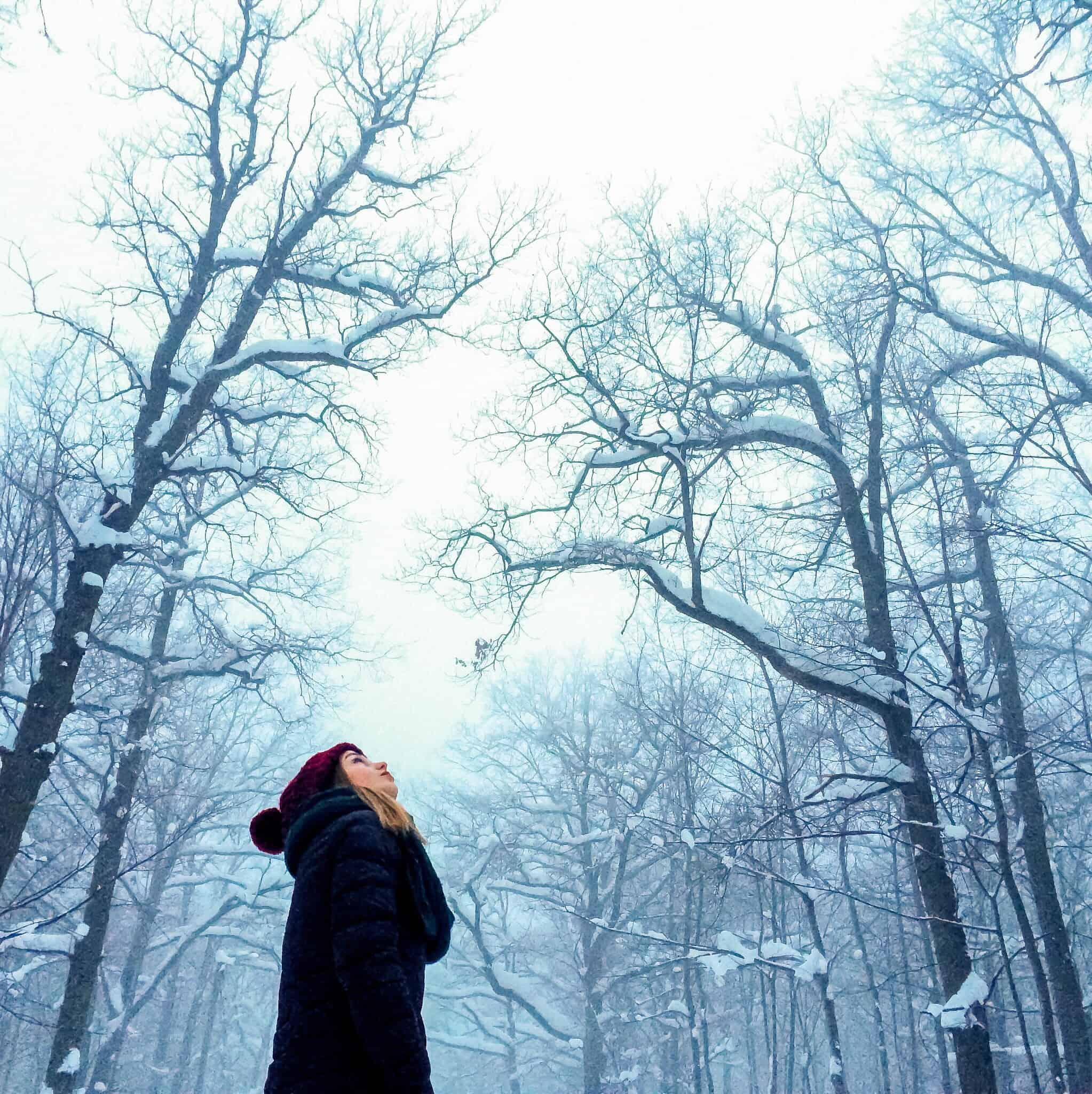Woman in snowy forest